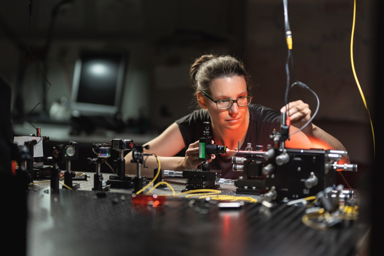 Jasmin Meinecke working on a laser table-top experiment in her laboratory at the Max Planck Institute of Quantum Optics.